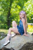 Little girl in jeans dress — Stock Photo