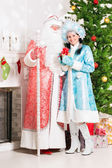 Snow maiden and santa claus — Stok fotoğraf