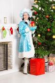 Snow maiden near christmas fir — Stock Photo