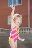 Little blond girl in swimsuit — Stock Photo