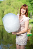 Red-haired woman with cotton candy — Stock Photo