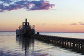 Ferryboat near the pier at sunset — Stock Photo