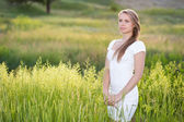 Dreamy young woman on the meadow — Stock Photo