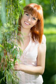 Red-haired smiling woman — Stock Photo
