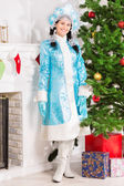 Snow maiden in blue coat — Stock Photo