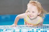 Little blond girl in water pool — Stock Photo
