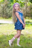Little blond girl in jeans dress — Stock Photo