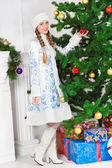 Woman in snow maiden costume — Stock Photo