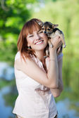 Red-haired woman with little dog — Stock Photo