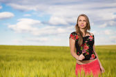 Attractive blond woman on the wheat field — Stock Photo