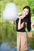Woman posing with a cotton cand — Stock Photo