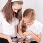 Two Girl with ipad like gadget — Stock Photo