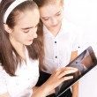 Two Girl with ipad like gadget — Stock Photo