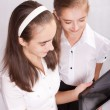 Two Girl with ipad like gadget - Foto Stock