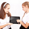 Two Girl with ipad like gadget — Stock Photo #22931106