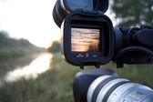 A videocamera filming river — Stock Photo