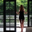 Woman on the veranda of the tropical house — Stock Video
