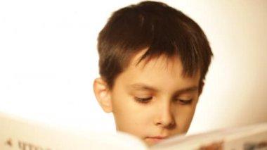 Boy reads books — Stock Video