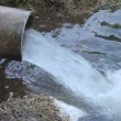 Industrial water pipe into river — Vidéo