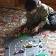 Boy plays with colorful toy cars — Stock Video