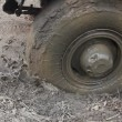 Wheel machine in the mud — Stok video