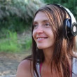 Girl with headphones by lake — Stock Video #25439639