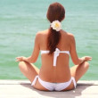 Woman on the beach near the sea meditating — Stock Video