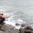 Stockvideo: Fisherman, sunset, sea, sun