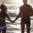 Loving couple on the beach — Vídeo de stock
