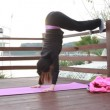 Young beautiful woman doing sports stretching exercise outdoors — Stock Video #40223619