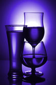 Silhouettes of glasses in blue. — Stock Photo