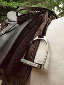 Saddle and stirrup — Stock Photo