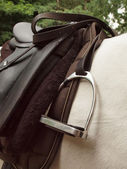 Saddle and stirrup — Stock Photo