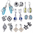 Earrings with zircon and expensive big gemstones — Stock Photo #23572383