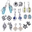 Earrings with zircon and expensive big gemstones — Stock Photo