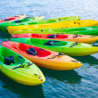 Colorful kayaks on water — Stock Photo