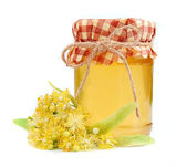 Linden honey with linden flowers. — Stock Photo