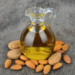 Almond oil with nuts — Stock Photo