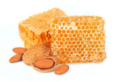 Almonds nuts with honeycomb — Stock Photo