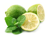Lobes of lime with mint — Stock Photo