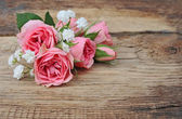 Bouquet roses on wooden background — Photo