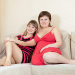 Relaxed women resting on sofa — Stock Photo #10526696
