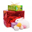 Easter rabbit with gifts — Stock Photo