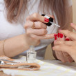 Stock Photo: Manicurist working with nails