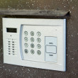 Stock Photo: Building intercom in door