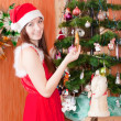 Woman near Christmas tree - Stock Photo