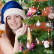 Happy girl near Christmas tree - Stock Photo
