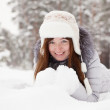Girl lying on snow - Stock Photo