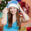 Girl in Santa hat - Stock Photo