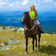 Royalty-Free Stock Photo: Female tourist on horseback